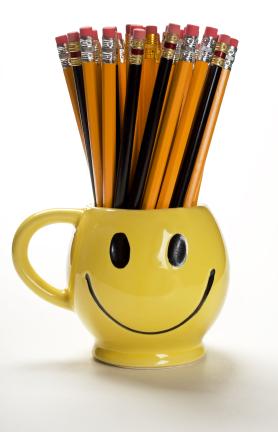 Smiling mug holding pencils