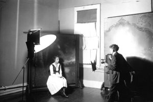 Adeline Cochems having her portrait taken by her father Edward W, Cochems in Santa Ana, California