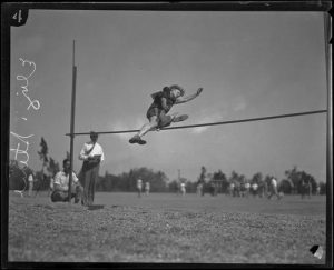 [Photograph: Elizabeth Stine, track athlete, engaged in high jump, circa 1922-1926]