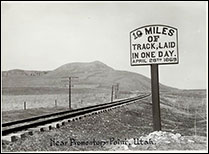Photograph of the the railroad, and a sign that reads, 10 miles of Track, laid I one day. April 28th 1869. 1869 Jan. 20